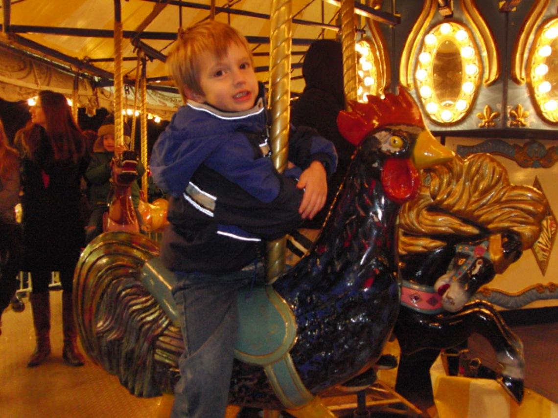 Boy on carousel at Prairie Lights