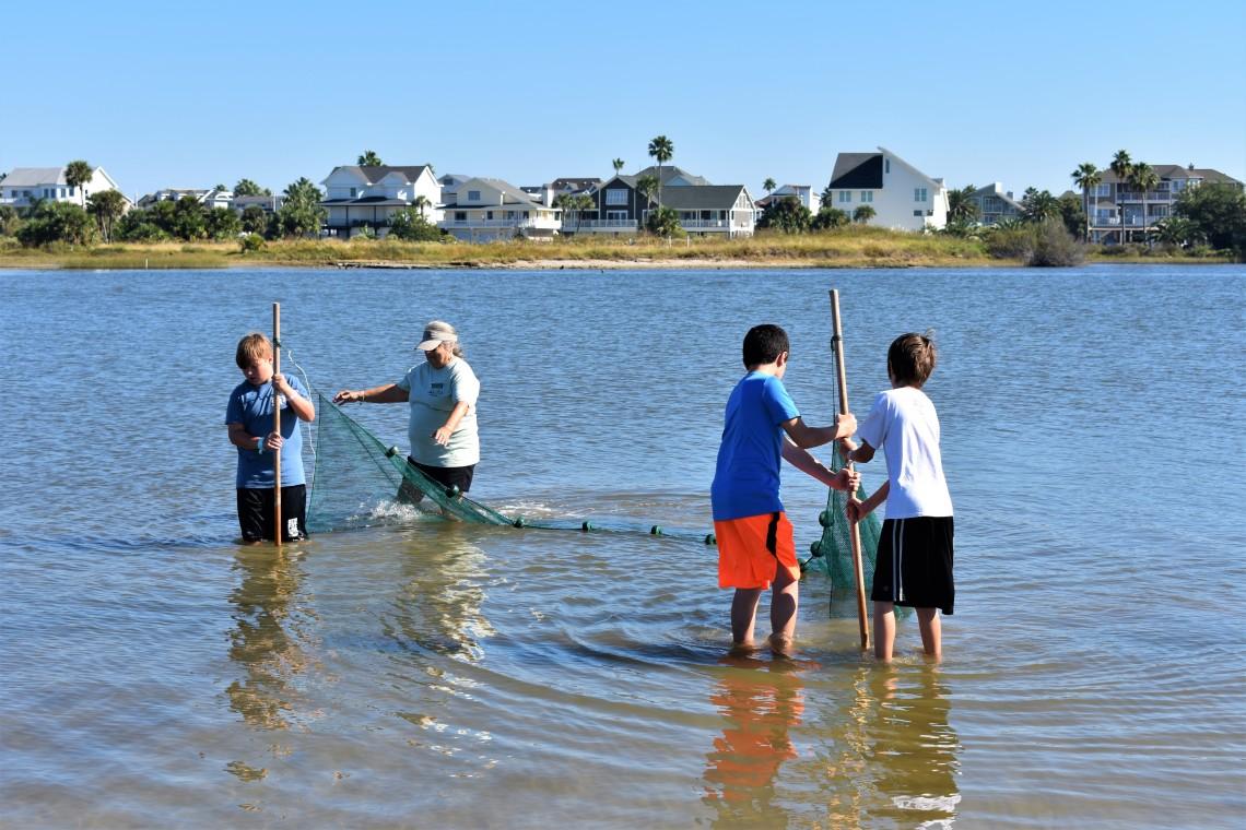 Bay Exploration boys seining at Galveston Island State Park