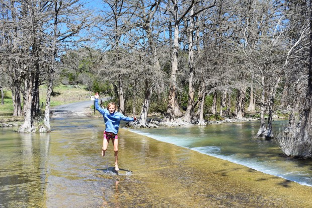 Girl jumping in the water on the Guadalupe River in Ingram Texas