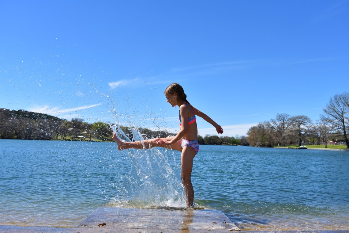 Girl playing in the water at Ingram Lake, in Ingram Texas on the Guadalupe River